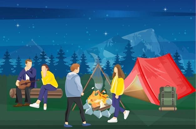 Pessoas em um piquenique no meio da noite Vetor Premium