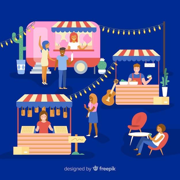 Pessoas em uma feira de noite Vetor grátis