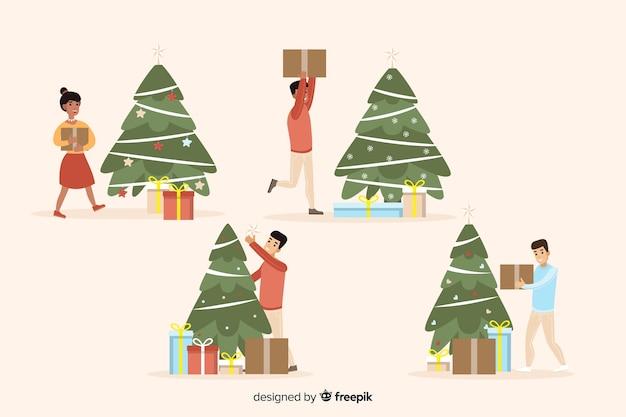 Pessoas felizes isoladas, decorar a árvore de natal Vetor grátis