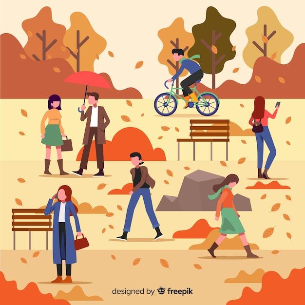 Pessoas planas andando no outono Vetor grátis