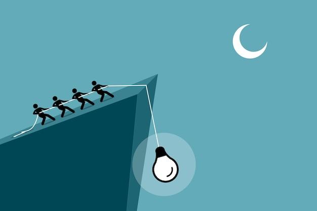Pessoas puxando uma ideia de uma queda do penhasco usando uma corda. Vetor Premium