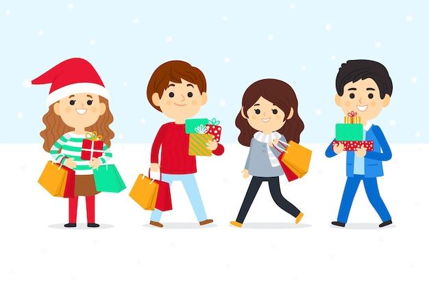 Pessoas que compram conjunto de presentes de natal Vetor grátis