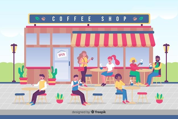 Pessoas tomando café no café Vetor grátis