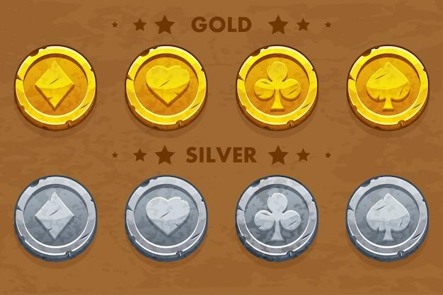 Pico, tref, chirva e pandeiro, moedas antigas de ouro e prata simbols de pôquer Vetor Premium