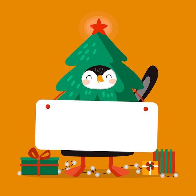 Pinguim de natal segurando bandeira em branco Vetor grátis