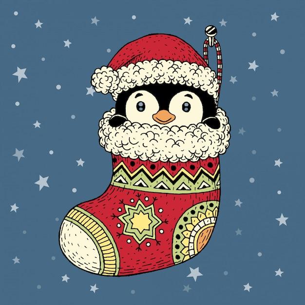 Pinguim desenhado de mão dentro de meia natal Vetor Premium