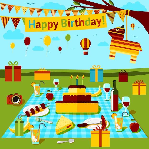 Piquenique de feliz aniversário com diferentes comidas e bebidas, presentes, piniata, vista para o campo. vetor Vetor Premium