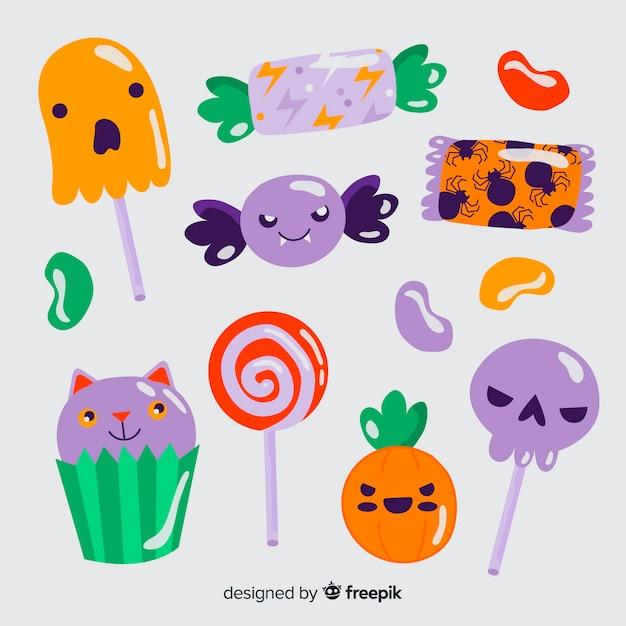 Pirulitos e doces de halloween mão desenhada Vetor grátis