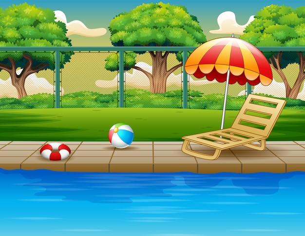 Piscina ao ar livre com espreguiçadeira e brinquedos Vetor Premium