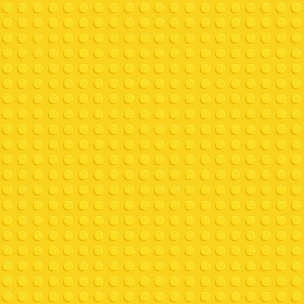 Placa de bloco de construção de plástico amarelo sem costura padrão Vetor Premium