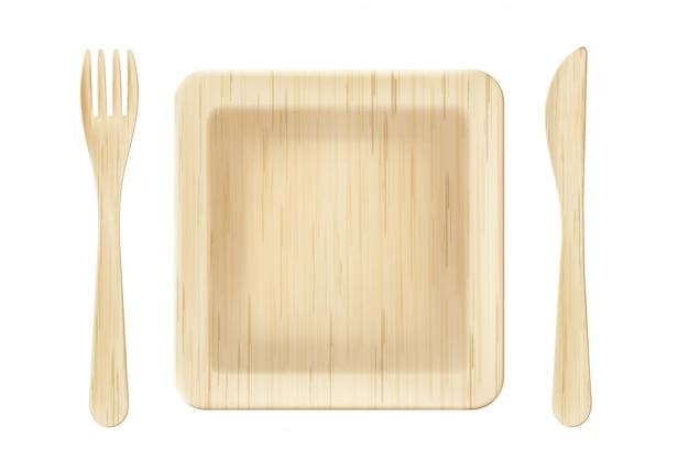 Placa de madeira com vista superior do garfo e faca Vetor grátis