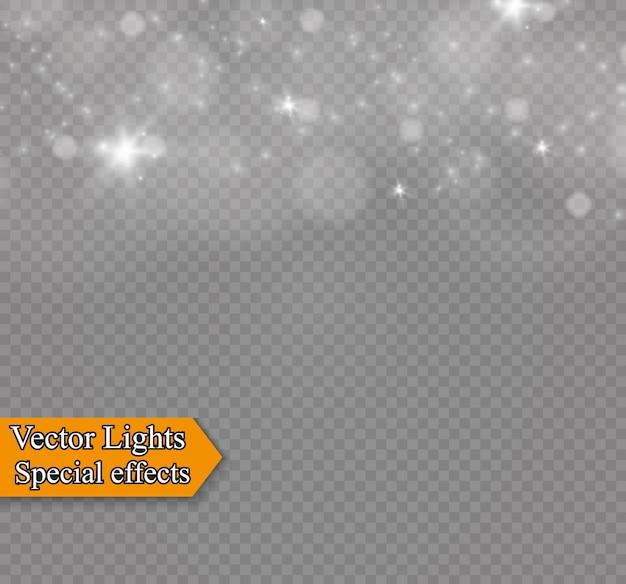 Poeira em um fundo transparente. estrelas brilhantes. o efeito de iluminação do brilho. Vetor Premium