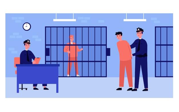 Policiais e homens presos no departamento de polícia Vetor Premium