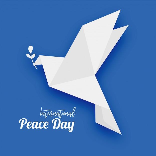 Pombo de origami com o símbolo da folha da paz Vetor Premium