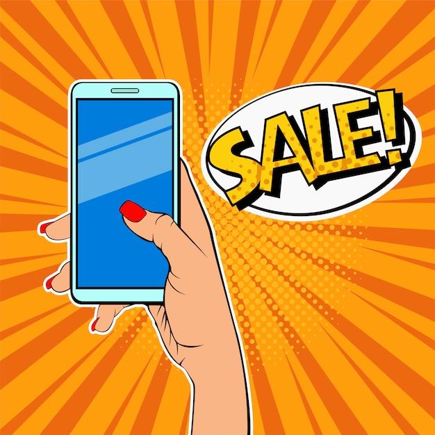 Pop art mão de mulher segurando smartphone e descrição venda Vetor Premium