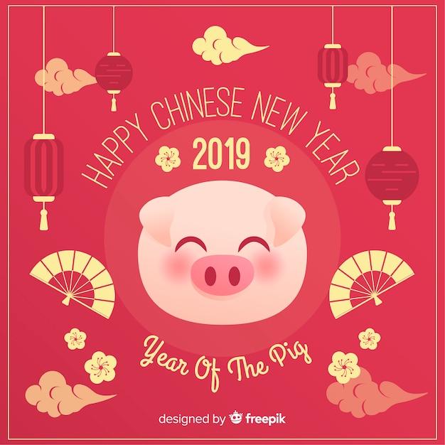 Porco enfrenta fundo de ano novo chinês Vetor grátis