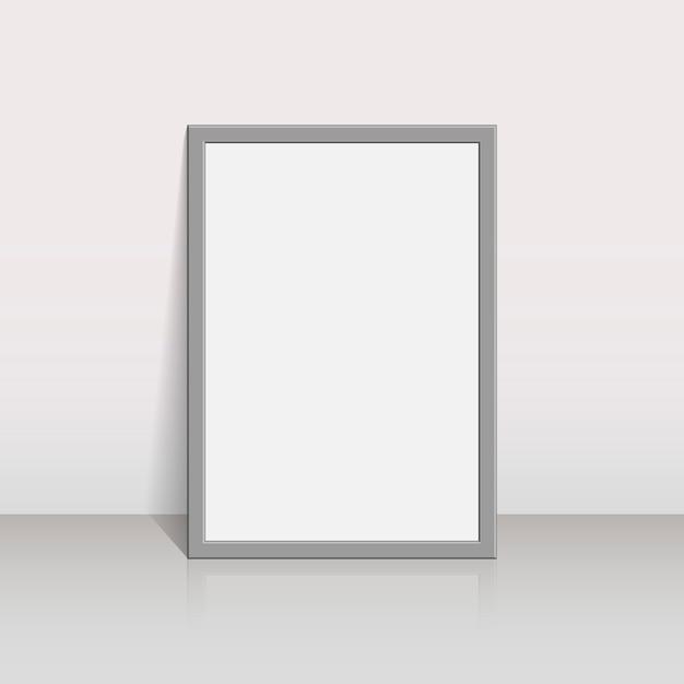 Porta-retrato em uma parede branca Vetor Premium