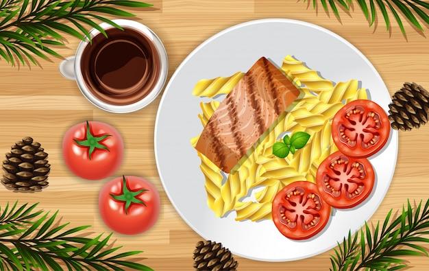 Posta de salmão close-up no fundo da mesa com alguns adereços de folhas Vetor Premium
