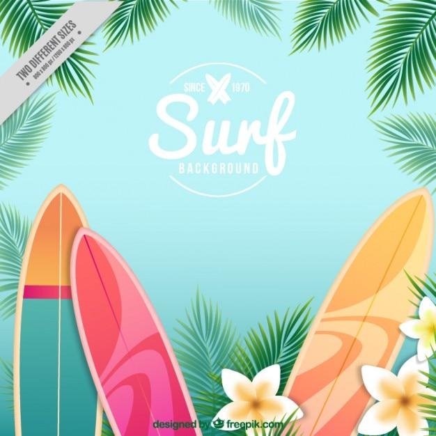 Pranchas de surf e fundo das flores Vetor grátis