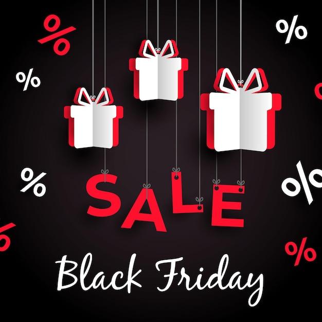 Presentes pendurados na sexta-feira negra em estilo de papel Vetor Premium