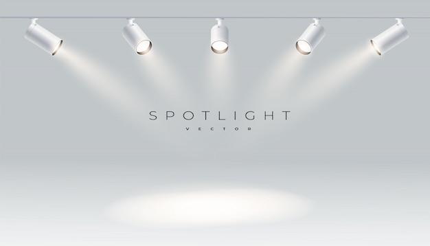 Projectores com luz brilhante branco brilhando conjunto de vetor de palco. projetor de forma de efeito iluminado, ilustração do projetor para estúdio Vetor Premium