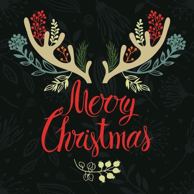 Projeto da tampa do cartão dos antlers do natal. caligrafia e ervas florestais Vetor grátis