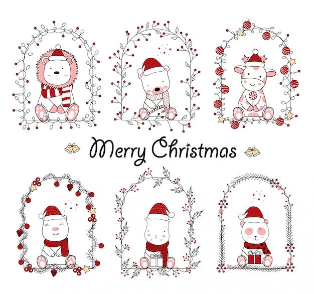 Projeto de natal com os desenhos animados de animais fofos no quadro floral. mão desenhada cartoon estilo Vetor Premium
