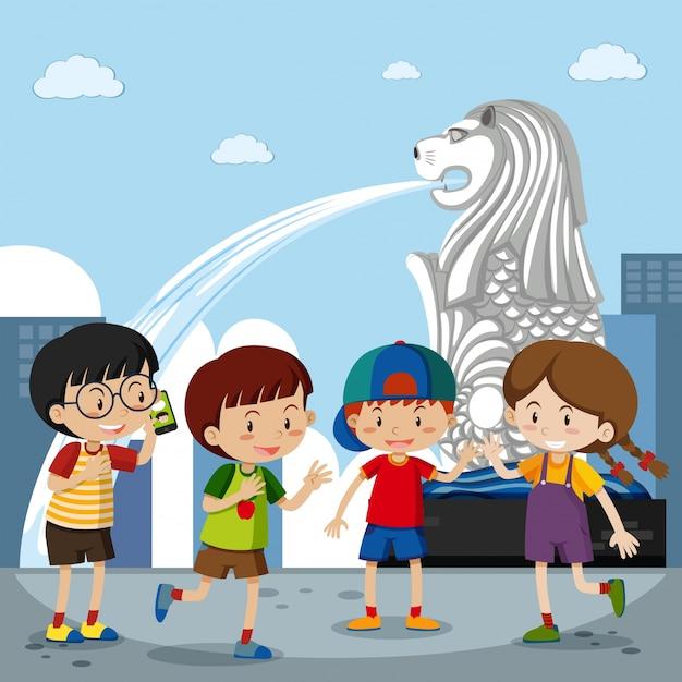 Quatro crianças no merlion em cingapura Vetor Premium