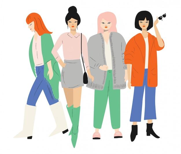 Quatro jovens mulheres em roupas de outono em pé e andando. isolado no branco plano Vetor Premium