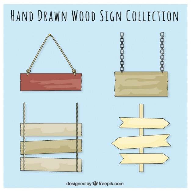 Quatro placas de madeira desenhado mão Vetor grátis
