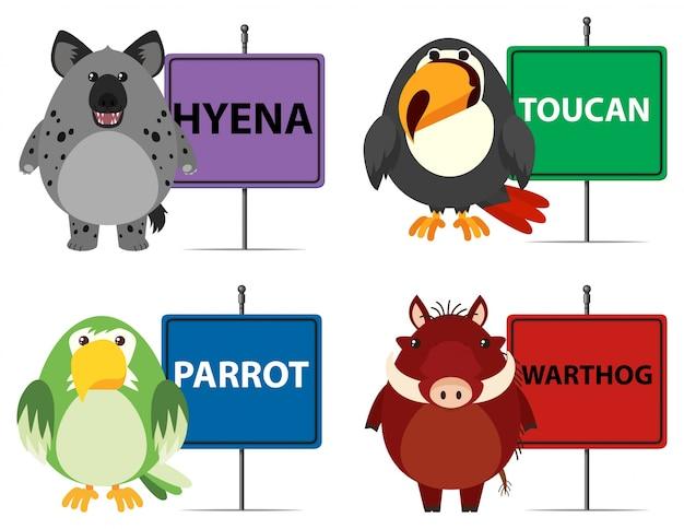 Quatro tipos de animais selvagens e sinais Vetor grátis