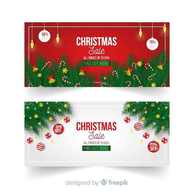 Realistic branches banner de venda de natal Vetor grátis