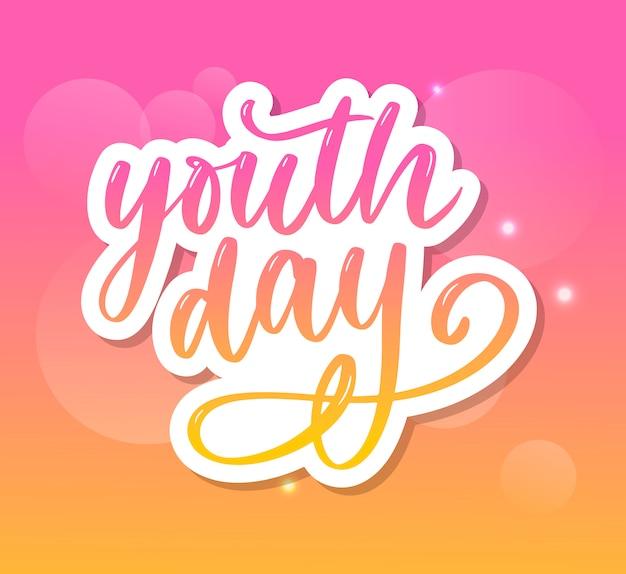 Rotulação do slogan de fundo amarelo de dia internacional da juventude Vetor Premium