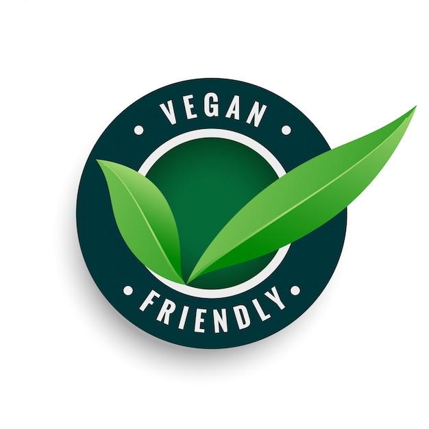 Rótulo de folhas amigáveis vegan na cor verde Vetor grátis