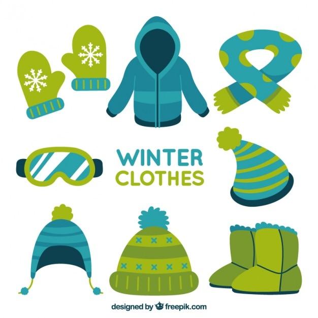 Roupas de inverno embalar com itens desenhados mão Vetor grátis