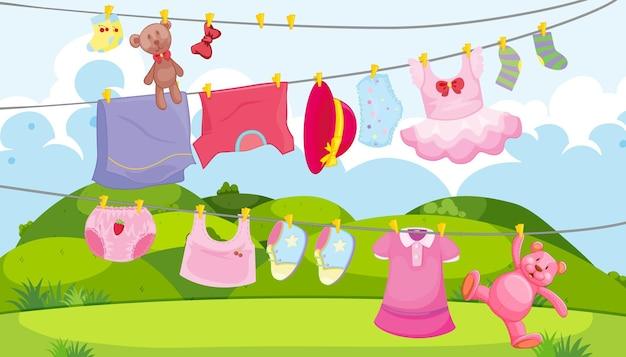Roupas infantis em um varal com acessórios infantis na cena ao ar livre Vetor grátis