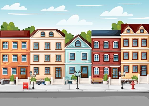 Rua com casas coloridas, banco de luzes de hidrantes, caixa de correio vermelha e arbustos em vasos, página de site de ilustração de estilo de desenho animado e aplicativo móvel Vetor Premium