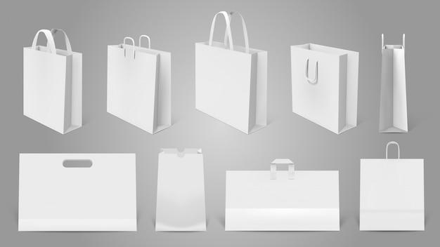 Sacola de compras realista. sacos vazios de papel branco, maquete moderna sacola de compras. conjunto de ilustração de modelos de embalagem. bolsa realista e vazio, pacote de mercadoria de varejo com alça Vetor Premium