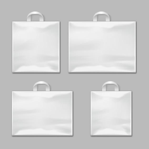 Sacos de compras plásticos reusáveis vazios brancos com os modelos do vetor dos punhos, modelos do projeto. pacote po Vetor Premium