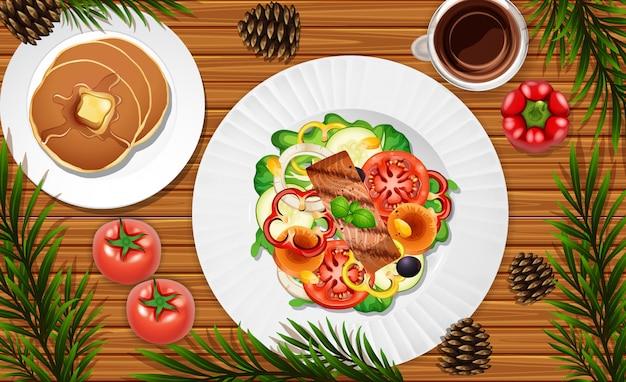 Salada e panqueca close-up no fundo da mesa com alguns adereços de vegetais Vetor Premium