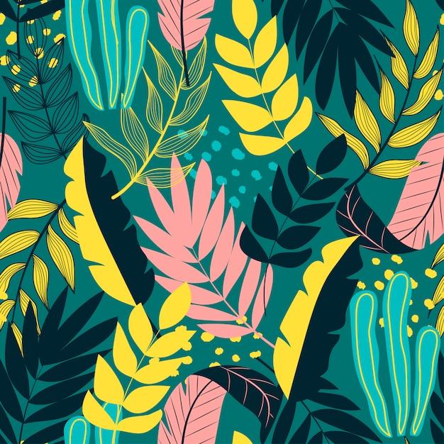 Sem costura padrão tropical com plantas e folhas Vetor Premium