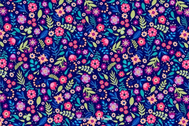 Servindo floral fundo com diferentes flores coloridas Vetor grátis