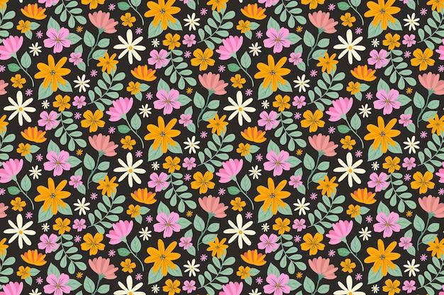 Servindo fundo floral com flores coloridas Vetor grátis