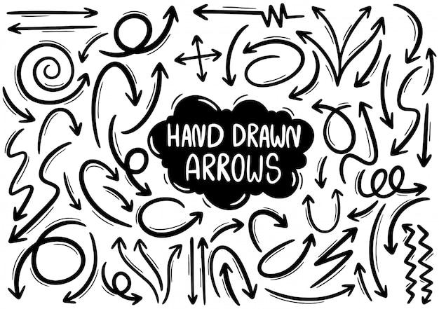 Setas desenhadas mão Vetor Premium