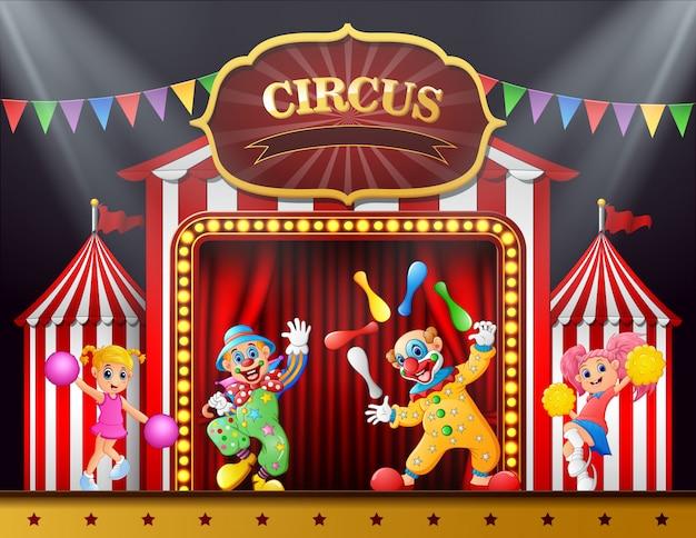 Show de circo com palhaços e líder de torcida na arena de palco Vetor Premium
