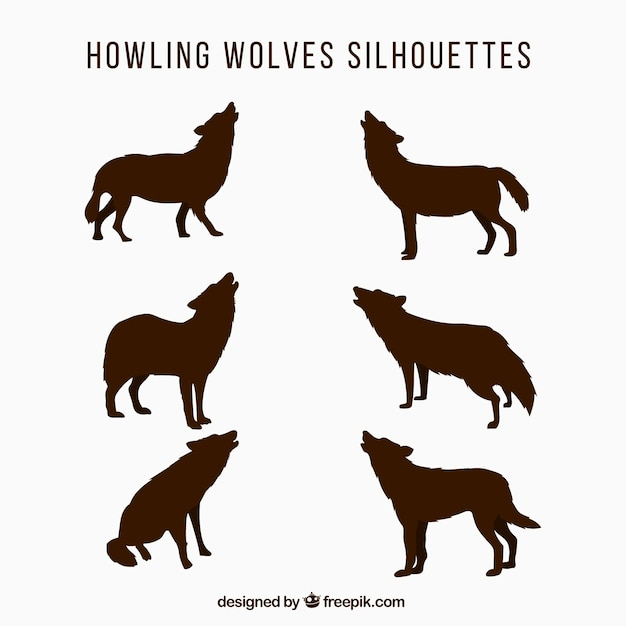 Silhouettes conjunto de lobos uivando Vetor grátis