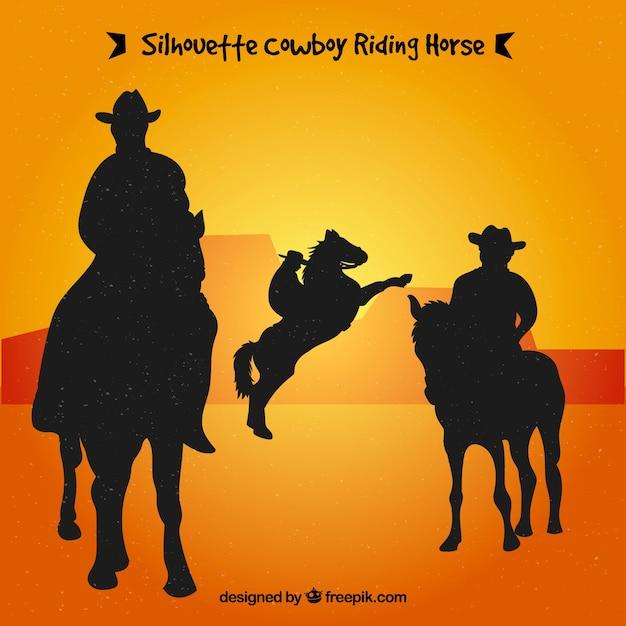 Silhueta de cowboys andando Vetor grátis