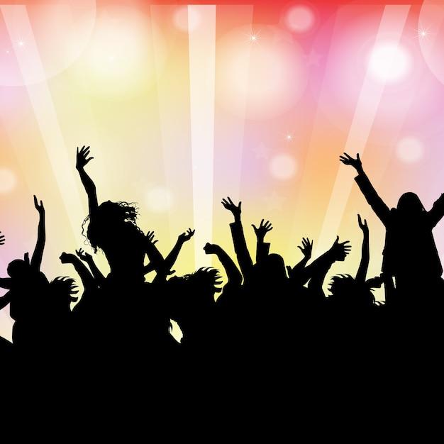 Silhueta de uma multidão de festa em um fundo de luzes de bokeh Vetor Premium