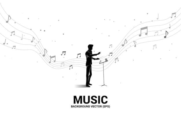 Silhueta do maestro em pé com nota musical a voar. fundo de conceito para concerto de orquestra e recreação. Vetor Premium