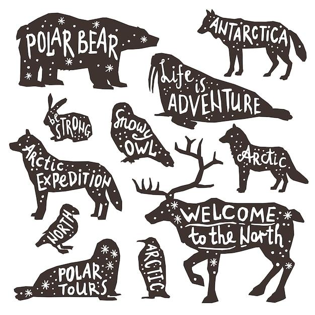 Silhuetas de animais polares Vetor grátis